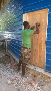 Even before I left, Bouki was already working on prepping the door for stain.